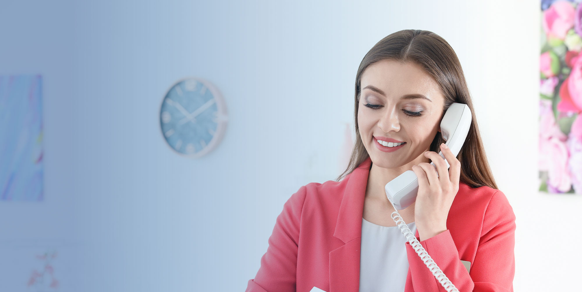 smiling woman while talking on the telephone